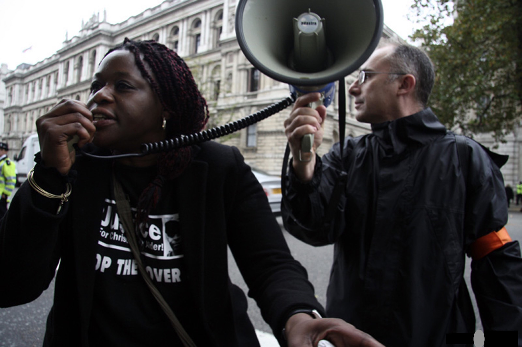 Janet Alder, sister of Christopher Alder, protests alongside Ken Fero